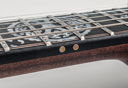 ROUNDED FRETBOARD EDGES AND BRASS INLAYS